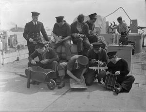 HANDY MEN OF THE CORVETTE SHELDRAKE. 10 MAY 1944, ON BOARD THE KINGFISHER CLASS CORVETTE HMS SHELDRAKE WHO'S CREW MAKE MODELS, TOYS AND SLIPPERS IN THEIR OFF DUTY MOMENTS.