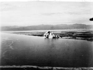 BRITISH EASTERN FLEET AIR ATTACK ON SIGLI. 18 SEPTEMBER 1944, FROM ATTACKING AIRCRAFT OF HMS VICTORIOUS, DURING A RAID BY CARRIER-BORNE BARRACUDAS, ESCORTED BY CHANCE-VOUGHT CORSAIR AND HELLCAT FIGHTERS, OF THE BRITISH EASTERN FLEET ON THE JAPANESE RAILWAY REPAIR AND MAINTENANCE CENTRE AT SIGLI, IN SUMATRA.
