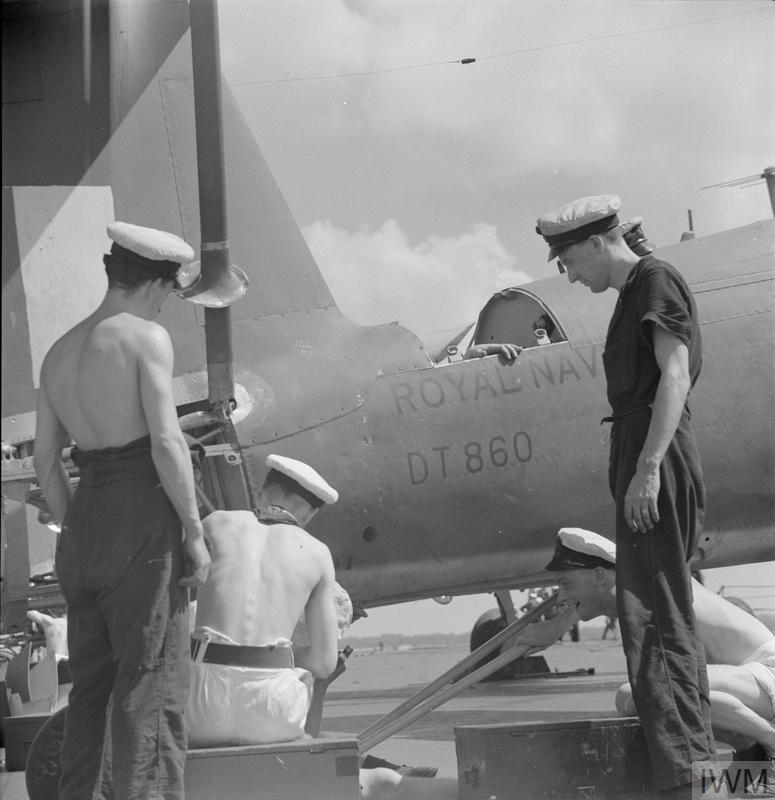 WITH AN EASTERN FLEET AIRCRAFT CARRIER. FEBRUARY 1944, ON BOARD THE REPAIR CARRIER HMS UNICORN, AT TRINCOMALEE.