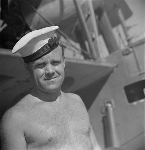 SERVING WITH AN EASTERN FLEET AIRCRAFT CARRIER. 14 FEBRUARY 1944, ON BOARD THE REPAIR CARRIER HMS UNICORN, AT TRINCOMALEE.
