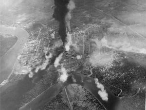 JAPANESE OIL REFINERY BOMBED. 4 JANUARY 1944, FROM ON BOARD AN ATTACKING AIRCRAFT DURING THE CARRIER-BORNE AIRCRAFT ATTACK ON PAGKALAN BRANDAN, JAPANESE HELD OIL REFINERY IN SUMATRA.