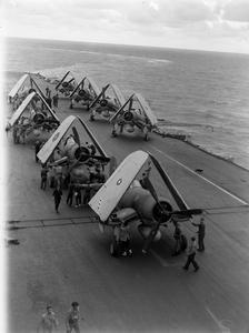 WITH AN EASTERN FLEET CARRIER. 21 DECEMBER 1944, ON BOARD AN AIRCRAFT CARRIER DURING AN EASTERN FLEET STRIKE ON BELAWAN DELHI.