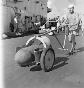 WITH AN EASTERN FLEET CARRIER. 21 DECEMBER 1944, ON BOARD AN AIRCRAFT CARRIER DURING AN EASTERN FLEET STRIKE ON BELAWAN DELHI.