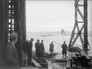 LAUNCH OF HM SUBMARINE ASTUTE. 30 JANUARY 1945, SHIPYARD OF VICKERS ARMSTRONG, BARROW-IN-FURNESS. MRS H PIZEY, WIFE OF COMMANDER E F PIZEY, DSO, RN, LAUNCHED THE SUBMARINE.
