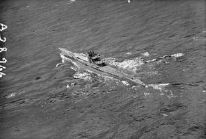 SURRENDERED U-BOATS SAIL INTO SCAPA. 31 MAY 1945, FROM A BRITISH NAVAL AIRCRAFT WHICH FLEW OVER THE U-BOATS AS THEY CAME INTO SCAPA FLOW FROM NORWAY. THERE WERE TWO BATCHES OF 10 AND 13.