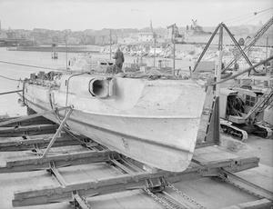 A GERMAN E-BOAT. 24 AND 25 APRIL 1945, PLYMOUTH. VARIOUS CONSTRUCTIONAL ASPECTS OF A RECOVERED SUNKEN GERMAN E-BOAT.
