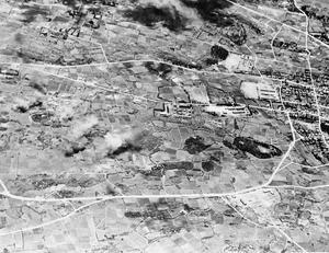 BRITISH WARSHIPS BOMBARD JAPANESE ISLAND OF MIYAKO. 4 MAY 1945, AERIAL PHOTOGRAPHS. UNITS OF THE BRITISH PACIFIC FLEET BOMBARDED JAPANESE MILITARY TARGETS NEAR HIRARA, A TOWN ON THE ISLAND OF MIYAKO, IN THE SAKISHIMA GROUP.