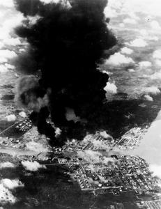 JAPANESE OIL REFINERIES BURNING DURING ATTACK BY BRITISH AIRCRAFT. JANUARY 1945, FROM ONE OF THE ATTACKING AIRCRAFT OF HMS VICTORIOUS DURING THE ATTACK ON JAPANESE OIL SUPPLIES AT PALEMBANG, IN SOUTHERN SUMATRA, BY CARRIER BORNE AIRCRAFT OF THE EAST INDIES FLEET.