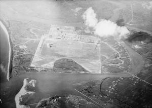 BRITISH NAVY PLANES BLAST AIRFIELD IN JAPAN. 24 JULY 1945, AERIAL PHOTOGRAPHS FROM ATTACKING AIRCRAFT OF THE BRITISH PACIFIC FLEET OPERATING WITH THE US 3RD FLEET IN STRIKES AGAINST THE JAPANESE HOME ISLANDS.