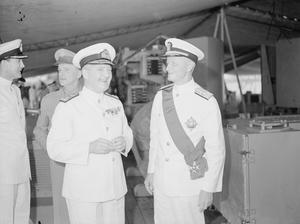 BRITISH HONOUR AMERICAN ADMIRAL. AUGUST 1945, ON BOARD HMS DUKE OF YORK, GUAM. ADMIRAL CHESTER W NIMITZ, COMMANDER IN CHIEF OF THE ALLIED NAVAL FORCES IN THE PACIFIC, RECEIVED THE ORDER OF THE KNIGHT GRAND CROSS OF THE BATH, ONE OF THE HIGHEST ORDERS IN THE BRITISH EMPIRE. ADMIRAL SIR BRUCE FRASER, COMMANDER IN CHIEF OF THE BRITISH PACIFIC FLEET, REPRESENTING HIS MAJESTY KING GEORGE, BESTOWED THE DECORATION ABOARD HIS FLAGSHIP HMS DUKE OF YORK.