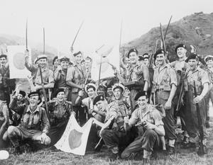 SOME OF HMS INDOMITABLE'S CREW IN HONG KONG. SEPTEMBER 1945, KAI TAK AIRSTRIP, HONG KONG.