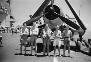 SERVING WITH THE ILLUSTRIOUS. APRIL 1945, ON BOARD THE BRITISH AIRCRAFT CARRIER HMS ILLUSTRIOUS SERVING IN EASTERN WATERS.