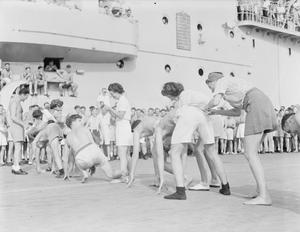 MEN OF THE BRITISH PACIFIC FLEET TUNE UP FOR CIVILIAN LIFE. FROM 3 OCTOBER 1945, ON BOARD THE AIRCRAFT CARRIER HMS INDOMITABLE AT SYDNEY HARBOUR AND ON THE JOURNEY BACK TO THE UNITED KINGDOM FOR
