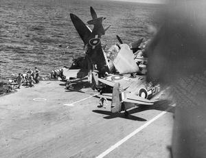 THE NAVY V THE JAPANESE. JUNE 1945, IN THE PACIFIC DURING AN ATTACK BY JAPANESE AIRCRAFT AGAINST CARRIERS OF THE BRITISH PACIFIC FLEET WHEN FIVE ENEMY PLANES WERE SHOT DOWN INTO THE SEA.