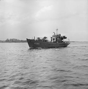 THE ROYAL NAVY AT KIEL. EX-GERMAN NAVAL PERSONNEL SWEEP MINES UNDER THE ORDERS AND SUPERVISION OF THE ROYAL NAVY.