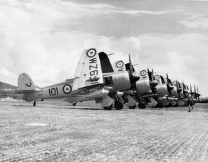 CARRIER AIRCRAFT VISIT HELICOPTER SQUADRON IN MALAYA. OCTOBER 1954, KUALA LUMPUR. 881 SQUADRON OF SEA FURY AIRCRAFT FLEW FROM THE LIGHT AIRCRAFT CARRIER HMS WARRIOR AT SINGAPORE TO PAY A VISIT TO 848 NAVAL HELICOPTER SQUADRON AT KUALA LUMPUR.