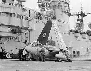 NAVY'S LATEST FIGHTERS EMBARK IN HMS EAGLE. 1 FEBRUARY 1954, ON BOARD THE AIRCRAFT CARRIER HMS EAGLE IN THE ENGLISH CHANNEL. NO 806 SQUADRON OF SEA HAWK JET FIGHTERS EMBARKED IN HMS EAGLE, THE FIRST TIME A SQUADRON OF SEA HAWKS WAS AFLOAT OPERATIONALLY.