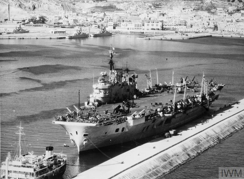 HMS EAGLE VISITS FRENCH NORTH AFRICA. 27 FEBRUARY 1954, THE AIRCRAFT CARRIER AT MERS EL KEBIR, ORAN.