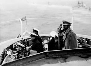 MEDITERRANEAN FLEET DEMONSTRATION FOR EMPEROR OF ETHIOPIA. OCTOBER 1954, ON BOARD THE CRUISER HMS GAMBIA, SAILING FROM MALTA TO THE UNITED KINGDOM. THE EMPEROR OF ETHIOPIA WITNESSED A DEMONSTRATION BY SHIPS OF THE MEDITERRANEAN FLEET.