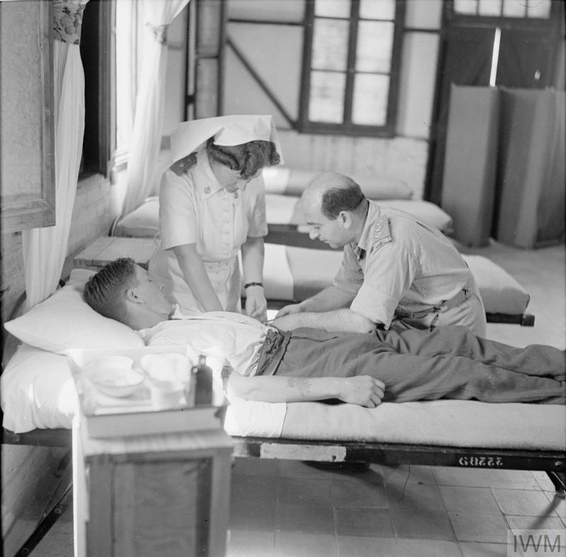 Psychiatric treatment; A patient is injected with Pentothal at No. 41 General Hospital, at Kantara East in Egypt, 1943. Pentothal was used to produce a state of drowsiness in which a patient became more amenable to suggestion, allowing a psychiatric doctor to find out more about the cause of their psychological condition.