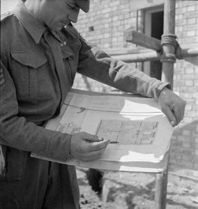 POST WAR PLANNING AND RECONSTRUCTION IN BRITAIN: GRENADIER GUARDSMEN BUILD EMERGENCY HOUSING IN WINDSOR