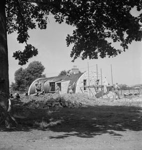 POST WAR PLANNING AND RECONSTRUCTION IN BRITAIN: GRENADIER GUARDSMEN BUILD EMERGENCY HOUSING IN WINDSOR