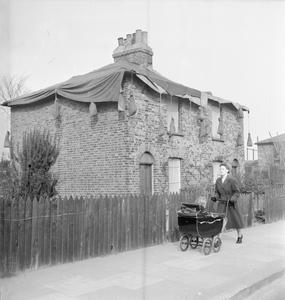 POST WAR PLANNING AND RECONSTRUCTION IN BRITAIN: REPAIRING BOMB DAMAGED HOUSING