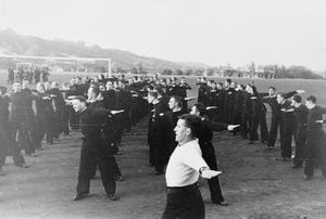 AUXILIARY PATROL SERVICE TRAINING SCHOOL. 1940, HMS EUROPA, THE TRAINING SCHOOL AT LOWESTOFT. FORMERLY A PLEASURE PARK, HMS EUROPA IS THE TRAINING SCHOOL FOR MEN OF THE ROYAL NAVY'S AUXILIARY PATROL SERVICE. HER NEW ENTRIES, MOSTLY FISHERMEN WHO ARE ALREADY EXPERT SEAMEN ARE TAUGHT GUNNERY, THERE ARE ALSO CLASSES FOR STOKERS AND SIGNALLERS.