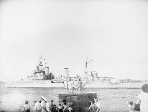 HMS GAMBIA LEAVING TRINCOMALEE TO PAY OFF. 31 JANUARY 1956, TRINCOMALEE, THE HEADQUARTERS BASE OF THE EAST INDIES STATION.
