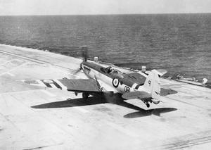 BRITISH SEAFIRE STRIKES OFF KOREA. JULY 1950, ON BOARD THE CARRIER HMS TRIUMPH OPERATING WITH THE CARRIER TASK FORCE OFF THE KOREAN COAST. SEAFIRE AIRCRAFT OPERATING FROM THE CARRIER ATTACKED NORTH KOREAN TARGETS WITH THE OBJECT OF HAMPERING SUPPLIES REACHING THE FRONT LINE.