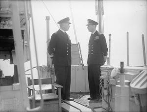 "THE KING WITH THE INVASION FLEET. 24 MAY 1944, ON BOARD THE HMS LARGS, HQ SHIP OF REAR ADMIRAL A G TALBOT, DSO, COMMANDER OF FORCE ""S"", AT PORTSMOUTH."