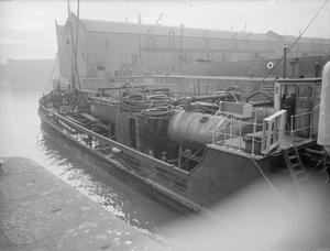 LITTLE SHIP'S BIG JOB. 1 AND 7 MARCH 1945, ALBERT AND WAPPING DOCKS, LIVERPOOL. THE TULIP, A 48 YEAR OLD, 925 TON EX-SANDHOPPER IS NOW AN OIL FUEL TANK CLEANER.