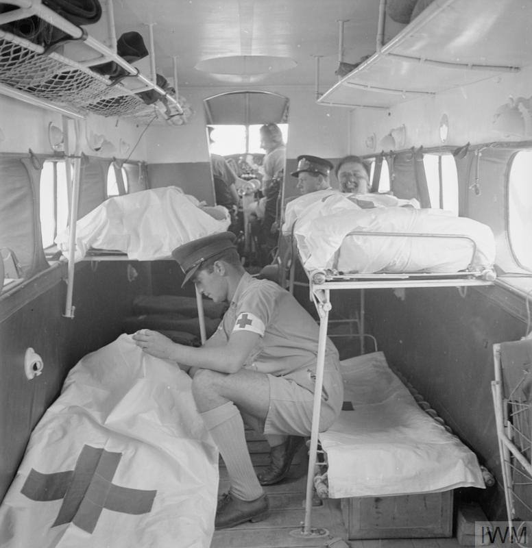 Air evacuations; Casualties are tended by medical orderlies of No.1 Air Ambulance Unit, Royal Australian Air Force, while being evacuated from the battle area in North Africa, Second World War. The use of aircraft was important in evacuating casualties across the wide expanses of desert in North Africa. Air evacuation was also vital in the thick jungle of Burma.