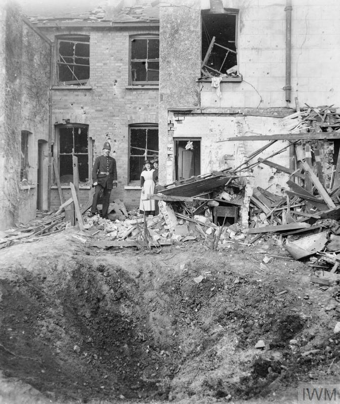 Sisters Naomi and Louisa Kemp outside the remains of their home at 34 Leslie Park Road, Croydon. Imperial War Museum image: Bomb damage at 33 Leslie Park Road, Croydon, sustained during the Zeppelin raid on the night of 13 - 14 October 1915. © IWM (HO 26)