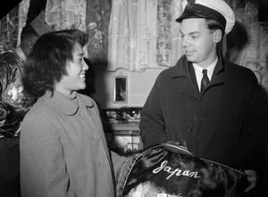 THE NAVY DOES CHRISTMAS SHOPPING IN JAPAN. SASEBO, JAPAN, DECEMBER 1952, MEN OF HMS DESTROYER CONSTANCE, WENT ASHORE TO DO CHRISTMAS SHOPPING IN A JAPANESE PORT DURING A SHORT STAY IN HARBOUR.