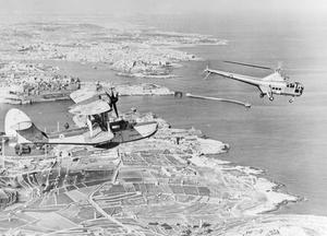 THE OLD AND THE NEW. 1953? THE WESTLAND-SIKORSKY DRAGONFLY HELICOPTER IS REPLACING THE SEA OTTER AMPHIBIOUS AIRCRAFT FOR AIR/SEA RESCUE DUTIES.