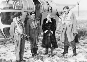 NAVY'S HELICOPTERS HELP FLOOD VICTIMS IN HOLLAND. FEBRUARY 1953. THE ROYAL NAVY'S 705 HELICOPTER SQUADRON, WITH 9 MACHINES, BROUGHT 725 PEOPLE TO SAFETY FROM THE FLOODED PARTS OF HOLLAND, AND HELPED TO RE-ESTABLISH COMMUNICATIONS. THEY HAD THE HONOUR TO FLY HM QUEEN JULIANA OF THE NETHERLANDS AND PRINCE BERNHARD TO DEVASTATED AREAS.