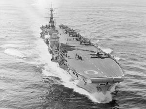 THE ADMIRAL PAID A VISIT. 11 JULY 1952, ON BOARD THE LIGHT FLEET CARRIER HMS OCEAN. DURING PATROLS OFF KOREA REAR ADMIRAL A K SCOTT-MONCRIEFF, DSO, FLAG OFFICER SECOND IN COMMAND, FAR EAST STATION, TRANSFERRED FROM HIS FLAGSHIP HMS BELFAST TO HMS OCEAN AND SPENT 4 DAYS ABOARD WHILE HER AIRCRAFT ATTACKED TARGETS IN NORTH WEST KOREA.