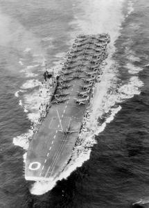 HMS OCEAN TAKES PART IN LARGE RAID ON PYONGYANG. 11 JULY 1952, AERIAL PHOTOGRAPHS OF, AND ON BOARD THE LIGHT FLEET CARRIER HMS OCEAN, AS SHE TOOK PART IN OPERATION PRESSURE PUMP, TARGETING THE NORTH KOREAN CAPITAL OF PYONGYANG. REAR ADMIRAL SCOTT-MONCRIEFF, FLAG OFFICER 2ND IN COMMAND FAR EAST STATION, AND TWO AMERICAN FLAG OFFICERS, ADMIRAL J J CLARKE, COMMANDER US 7TH FLEET, AND REAR ADMIRAL GINGRICH, WATCHED THE RETURN OF THE SECOND STRIKE AIRCRAFT TO HMS OCEAN FROM THE BRIDGE.