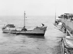 HMS BULWARK TOWS STRICKEN DUTCH SHIP TO SAFETY. 29 FEBRUARY 1956, ON BOARD THE AIRCRAFT CARRIER HMS BULWARK WHEN SHE TOOK IN TOW THE 300 TON DUTCH SHIP RIGEL WHICH WAS IN TROUBLE IN THE IRISH SEA AND MADE TOWARDS HARBOUR.