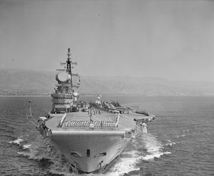 HMS HERMES AT MESSINA, SICILY. JULY 1960, THE AIRCRAFT CARRIER PAID A FOUR DAY VISIT TO THE PORT OF MESSINA.