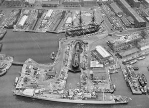 THE OLDEST AND THE NEWEST SHIPS IN THE FLEET. OCTOBER 1970, AERIAL PHOTOGRAPH FROM A WASP HELICOPTER OVER PORTSMOUTH DOCKYARD, HANTS.