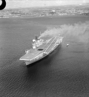 HMS EAGLE GOES TO SEA FOR TRIALS. MAY 1964, LEAVING PLYMOUTH FOR TRIALS. HMS EAGLE WAS EXTENSIVELY MODERNISED AND FITTED WITH MANY FEATURES NEW TO AIRCRAFT CARRIERS.