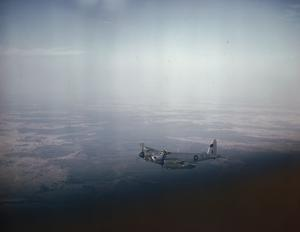 ROYAL AIR FORCE PHOTOGRAPHIC RECONNAISSANCE MOSQUITO IN FLIGHT OVER BENGAL, MARCH 1945