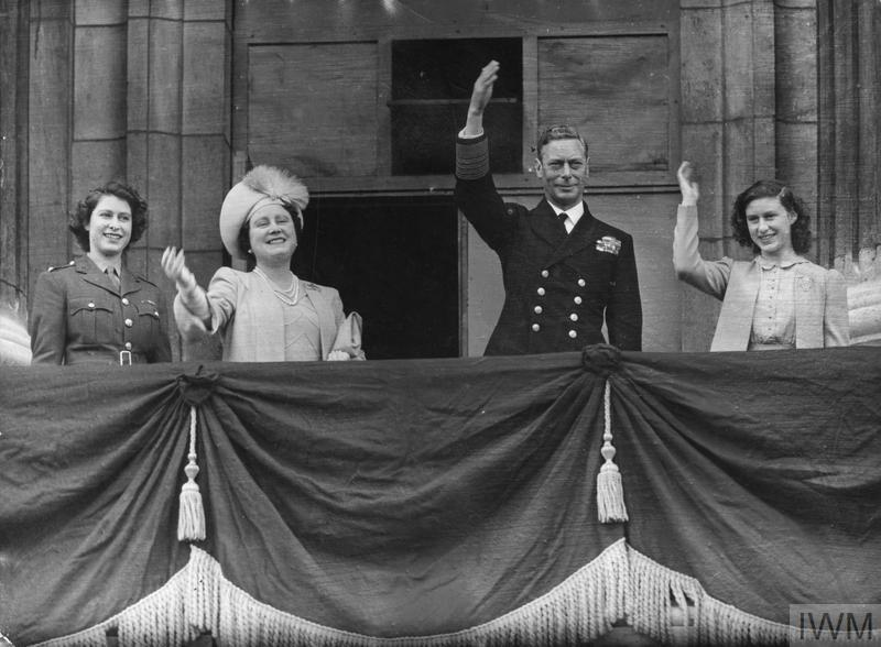 The Royal Family on the balcony of Buckingham Palace on VE Day smiling and waving at the gathered crowds.