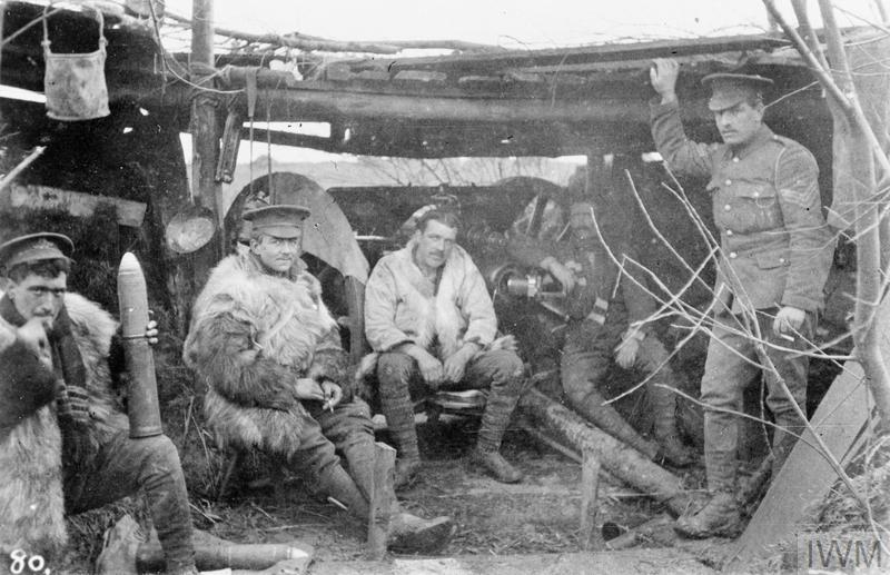 An 18-pounder field gun and crew of the Royal Field Artillery in a gun emplacement on the Armentieres sector of the front line, 7 December 1914.