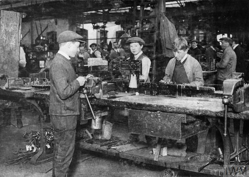 Young male labourers assembling aircraft switch part for the motor control switch gears at an airplane factory.