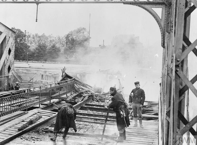 Belgian Army engineers in the process of destroying a railway bridge in Termonde to halt the German advance before retreating to Antwerp on 18 September 1914.