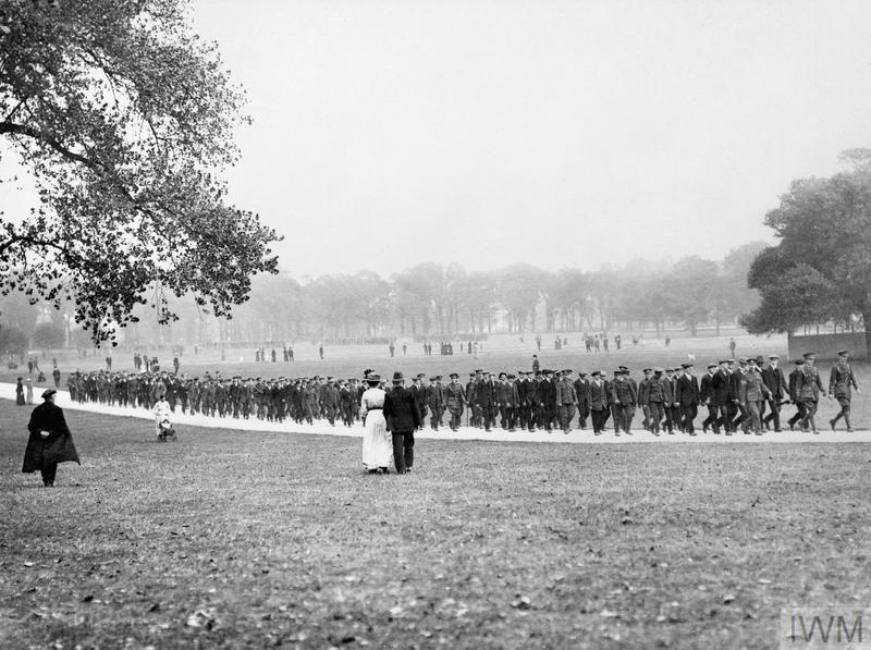 British Army recruits march through Regent's Park in London as civilians look on, September 1914.