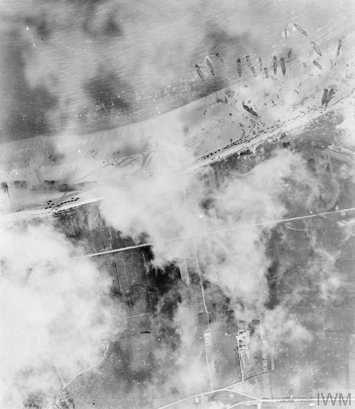 Vertical aerial photograph of the landings on Mike beach, Juno area, to the west of Courselles-sur-Mer, 6 June 1944.